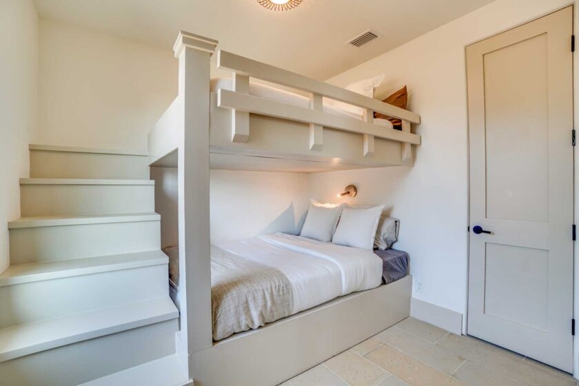 bedroom with built in bunks and coastal look