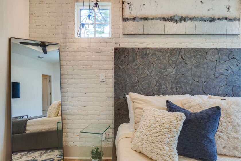 bedroom accent wall with two high windows